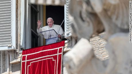 Pope Francis waves from a window overlooking St. Peter's Square in the Vatican during the weekly Angelus prayer followed by the recitation of the Regina Coeli on May 9, 2021.