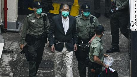 Hong Kong media tycoon Jimmy Lai, founder and owner of Apple Daily newspaper is seen handcuffed and escorted by the guards leaving Lai Chi Kok Reception Centre on December 12, 2020, in Hong Kong, China.