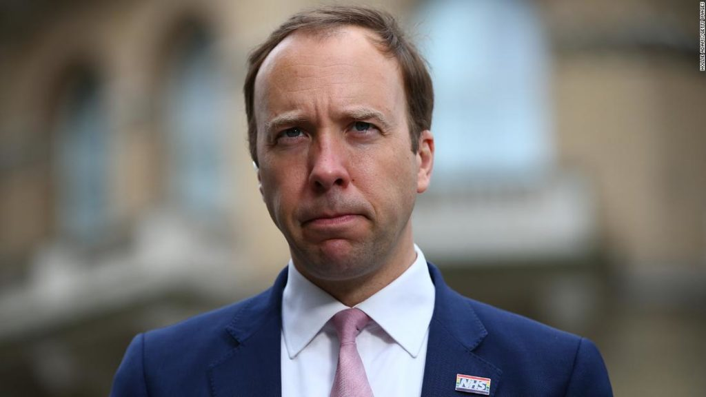 Matt Hancock, Britain's beleaguered health secretary, apologizes after being caught in embrace with aide