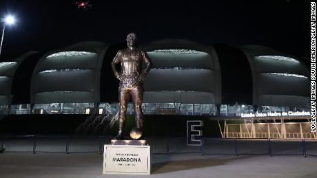 A 16-foot-5-inch tall statue of late football legend Diego Maradona is unveiled at the Estadio Unico Madre de Ciudades.