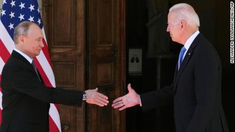 Russian President Vladimir Putin, left, and U.S President Joe Biden shake hands during their meeting at the 'Villa la Grange' in Geneva, Switzerland in Geneva, Switzerland, Wednesday, June 16, 2021.