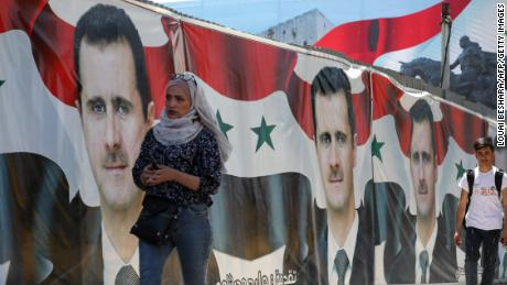 Syrians vote in 'non-event' presidential election set to be won by Assad
