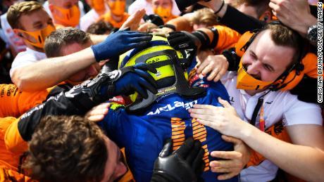 Norris enthusiastically celebrates his podium finish.
