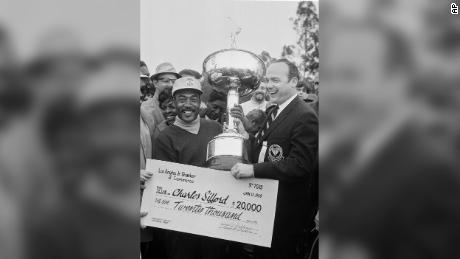 Sifford is presented a check for $20,000 plus the trophy after winning the Los Angeles Open.