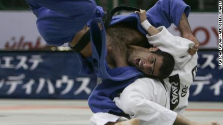 Iran's Vahid Sarlak duels with Spain's Javier Fernandez in the up to and including 60 kgs men's open category during the World Judo Championships in Cairo in September 2005. Sarlak says he was forced to default from the tournament after he'd been drawn against an opponent from Israel.