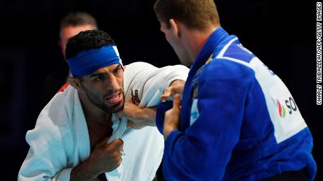 Iran's Saeid Mollaei (in white) fights against Belgium's Matthias Casse during the semifinal of the men's under 81kg category during the 2019 Judo World Championships at the Nippon Budokan, a venue for the upcoming Tokyo 2020 Olympic Games. Mollaei, who claimed he was ordered to deliberately lose a world championship fight, could compete under a refugee flag at the 2020 Tokyo Olympics, officials said on September 1.
