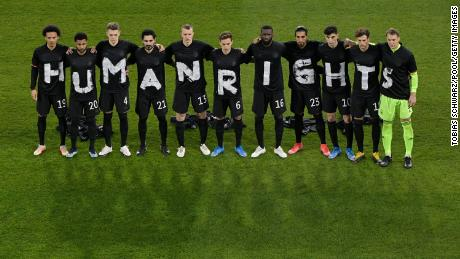 """Players of Germany wear t-shirts which spell out """"Human Rights"""" prior to the FIFA World Cup 2022 Qatar qualifying match between Germany and Iceland on March 25, 2021 in Duisburg, Germany."""