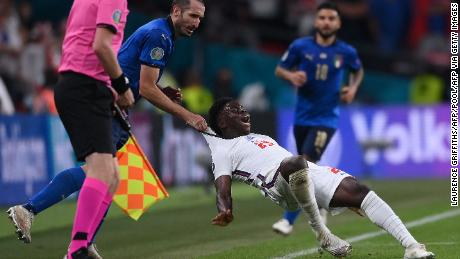 Giorgio Chiellini drags Bukayo Saka after being turned by the England forward.