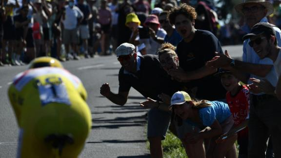 Spectators cheer on Pogacar during the 20th stage of the 108th edition of the Tour de France cycling race.