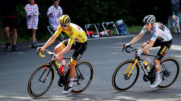 Pogacar rides ahead of Team Jumbo Visma's Jonas Vingegaard of Denmark during the 18th stage between Pau and Luz Ardiden, on July 15, 2021.