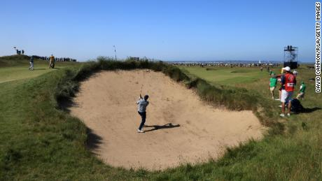 Spieth plays his second shot on the 7th hole at Royal St George's.