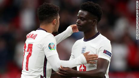 Bukayo Saka (right) and team mate Jadon Sancho (left) during the UEFA Euro 2020 Championship Group D match between Czech Republic and England at Wembley Stadium on June 22, 2021.