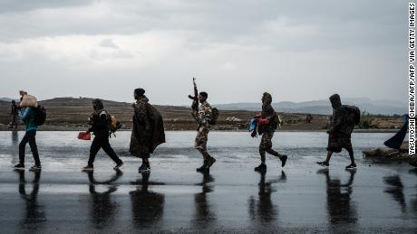 Soldiers from the Tigray Defense Force (TDF) walk in lines towards another field in Mekele, the capital of Ethiopia's Tigray region, on June 30.