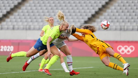 Stina Blackstenius opens the scoring for Sweden with a smart header.