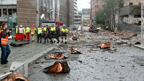 Firefighters work at the site of the explosion near government buildings in the Norwegian capital, Oslo, on July 22, 2011.