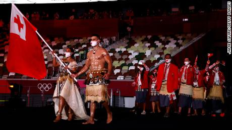 Pita Taufatofua leads out Team Tonga during the opening ceremony.