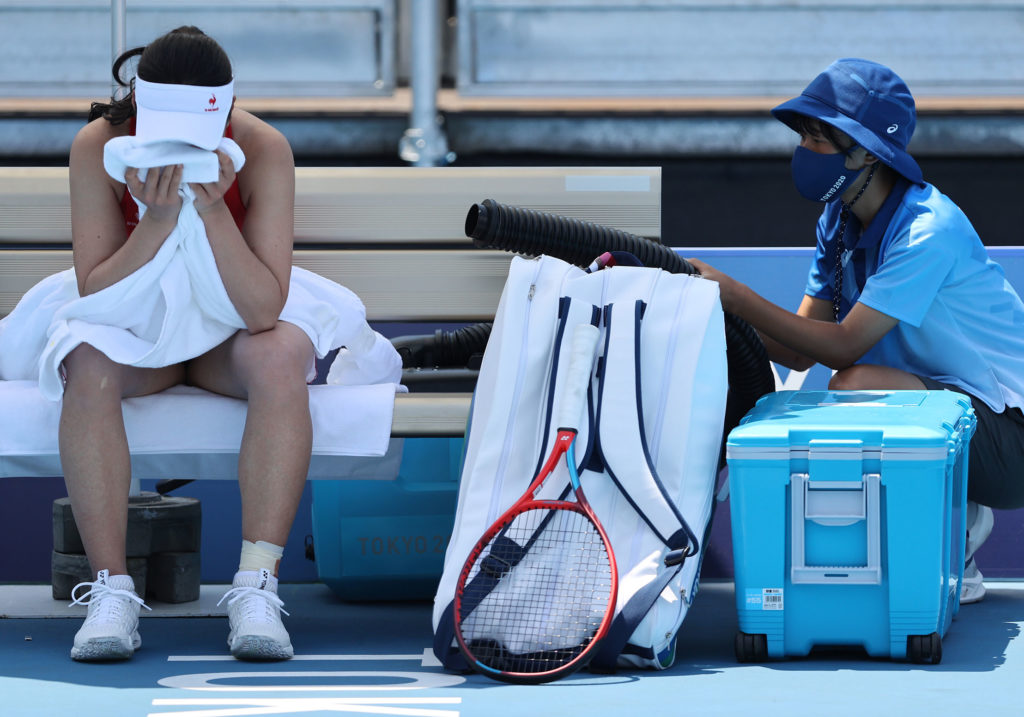 Nao Hibino of Japan cools down between games during her Women's Singles First Round match on July 24.