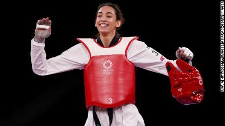 Alizadeh celebrates after defeating Jade Jones of Team Great Britain.