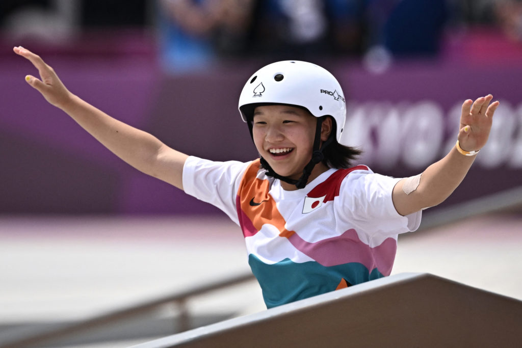 Japan's Nishiya Momiji celebrates after performing a trick during the skateboarding street final on July 26.