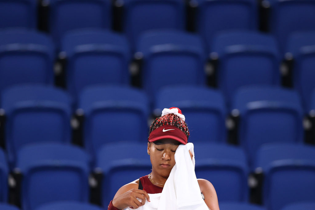 Japan's Naomi Osaka wipes her face after losing her third round match against Marketa Vondrousova of the Czech Republic on Tuesday.