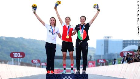 Kiesenhofer (middle) plans to lecture at her university next semester, where colleagues and students know her for her achievements on the track.