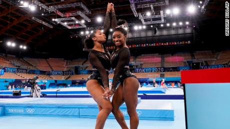 Simone Biles, of the United States, right, poses for pictures with teammate Jordan Chiles after an artistic gymnastics practice session at the 2020 Summer Olympics in Tokyo.