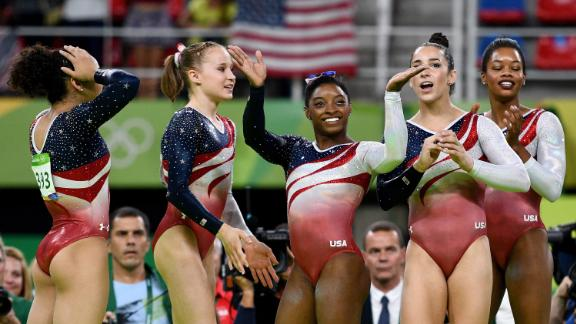 From left, Laurie Hernandez, Madison Kocian, Biles, Aly Raisman and Gabby Douglas celebrate winning the gold medal during the team final of the 2016 Olympics.