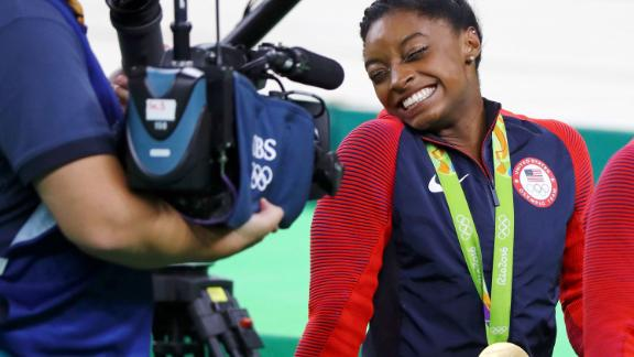 Biles reacts to a camera after winning the individual all-around final at the 2016 Olympics.