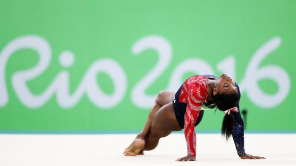 Biles competes on the floor at the 2016 Olympics.
