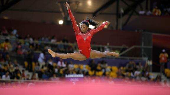 Biles performs on the floor during the 2018 World Championships.