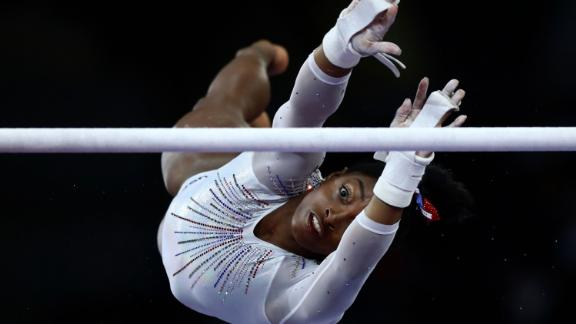 Biles performs on the uneven bars at the 2019 World Championships.
