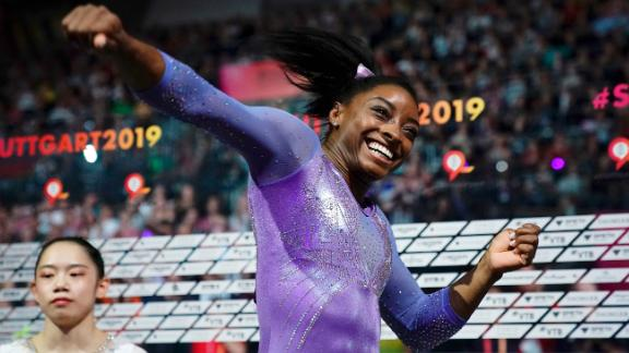 Biles celebrates after winning the beam apparatus final at the 2019 World Championships.