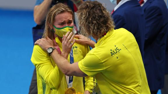 Titmus reacts with her coach Dean Boxall after winning the gold medal in the women's 200m freestyle.