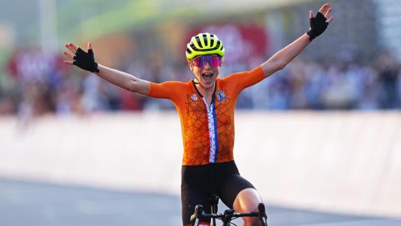 van Vleuten celebrates as she crosses the finishing line of the women's road race to win the silver medal.
