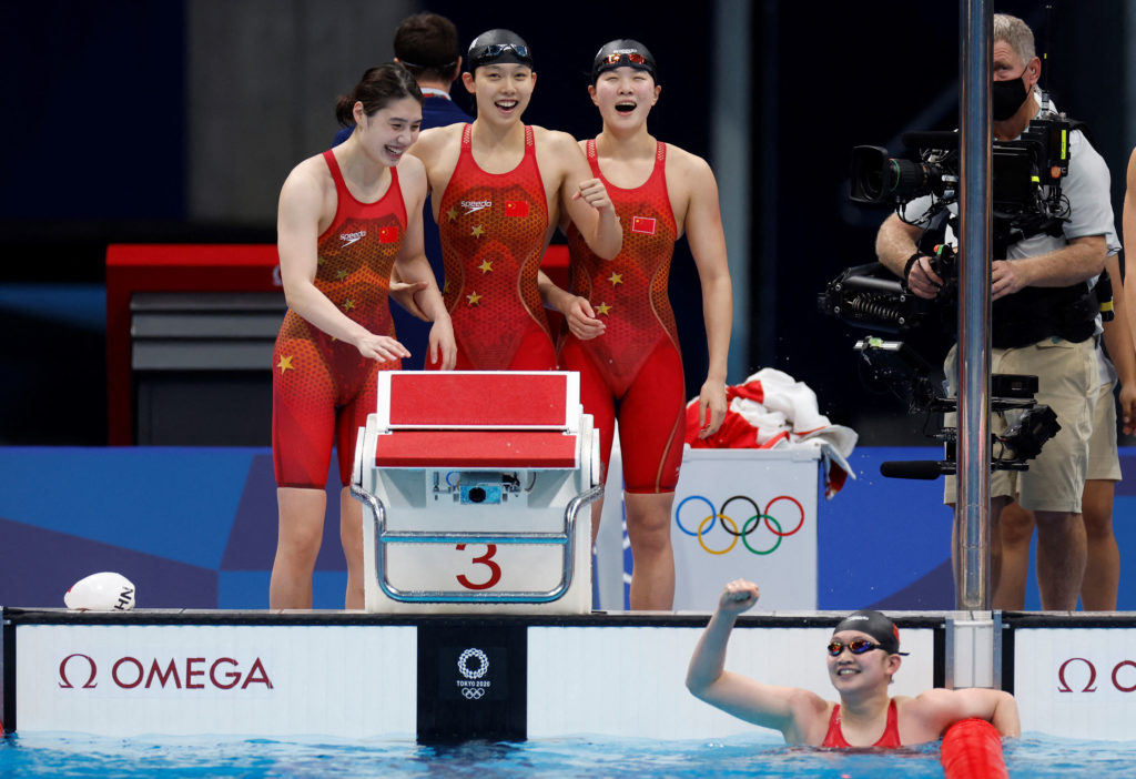 The Chinese team celebrates after taking gold in the 4x200-meter freestyle on July 29.