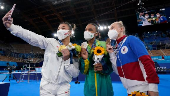 Lee takes a selfie with silver medalist Rebeca Andrade, center, and bronze medalist Angelina Melnikova. Andrade is the first Brazilian to ever medal in women's gymnastics. Melnikova is Russian.