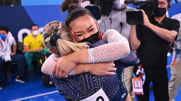 Lee is congratulated by teammate Jade Carey after winning the gold.