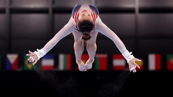Lee soars in the air during the uneven bars.