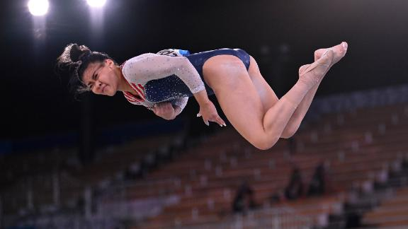 Lee twists in the air during her floor exercise routine.