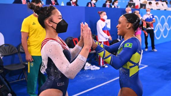 Lee congratulates Brazil's Rebeca Andrade after the floor exercise. Andrade had a chance to overtake Lee at the end, but she stepped out of bounds twice during her floor routine.