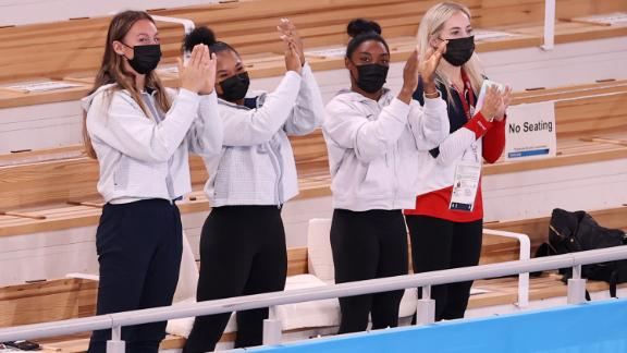 From left, US gymnasts Riley McCusker, Jordan Chiles, Simone Biles and MyKayla Skinner cheer for Lee after her gold-medal performance. Biles, the defending champion, withdrew from the event because of mental-health concerns.