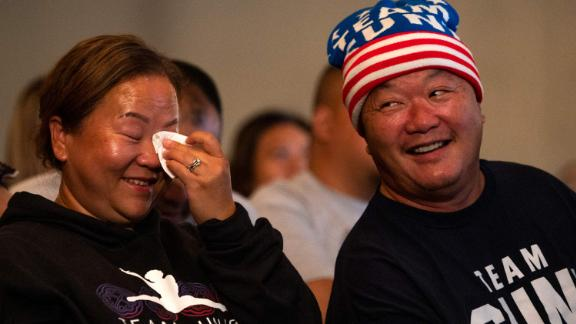 Lee's parents, Yeev Thoj and John Lee, react while watching their daughter from Oakdale, Minnesota. In 2019, John Lee<a href=