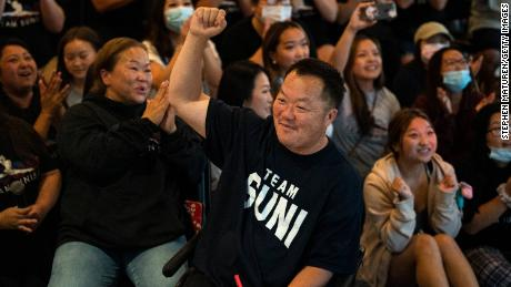 John Lee, father of US gymnast Suni Lee, celebrates after his daughter won the Olympic all-around title.