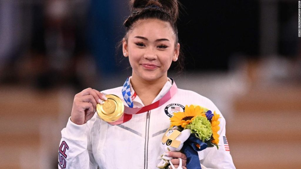 Suni Lee: US gymnast wins Olympic all-around after injuries, tragedies and a horrific accident