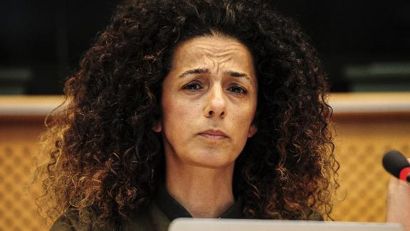 Iranian journalist and writer Masih Alinejad listens during an event at European Parliament headquarters in Brussels in 2016.
