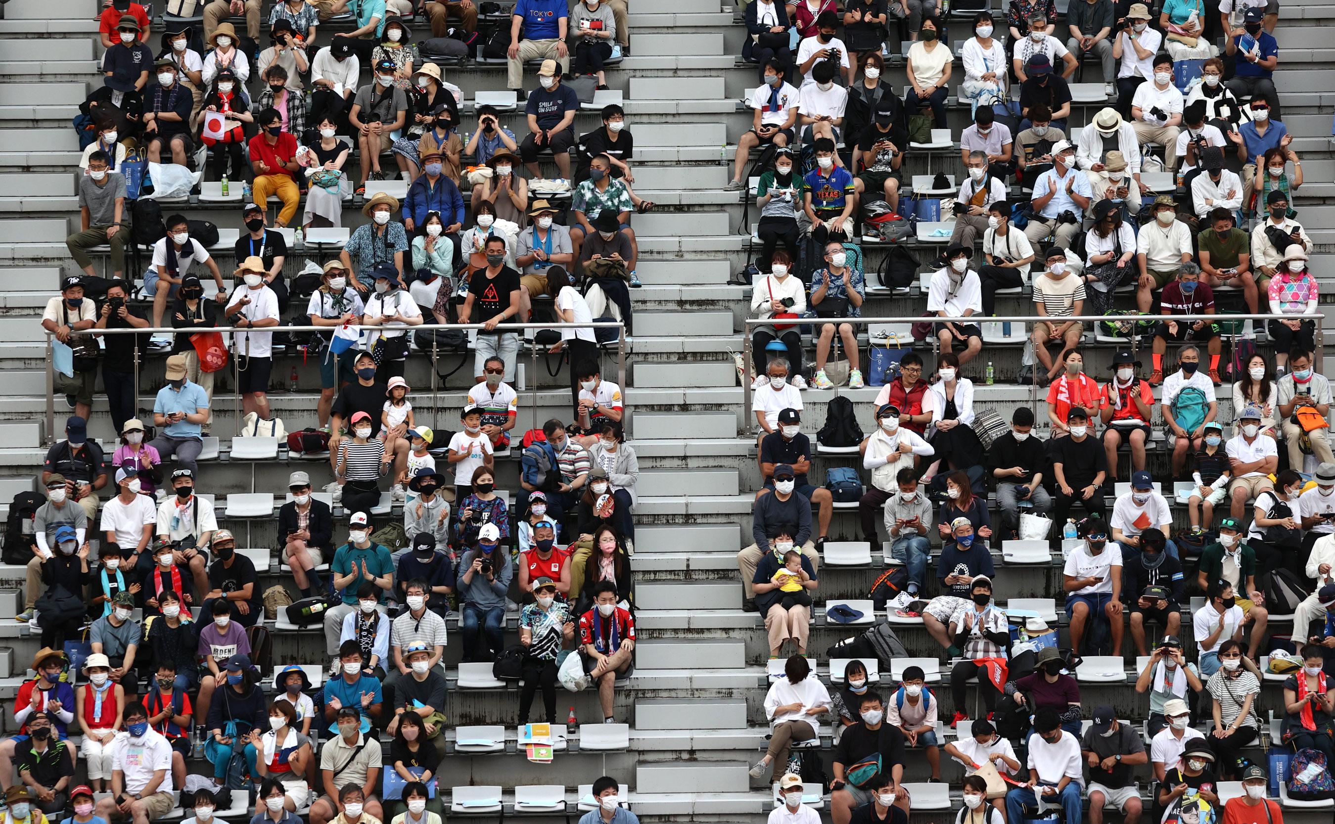 Fans watch the Men's road race at Fuji International Speedway.
