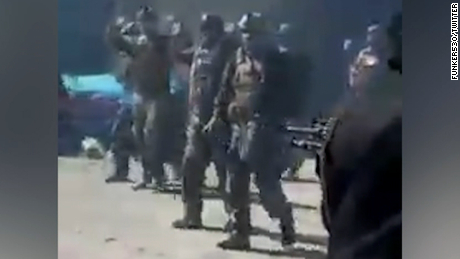 Taliban fighters execute 22 Afghan commandos as they try to surrender