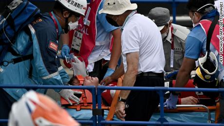 Fields receives medical assistance after crashing in the BMX racing semifinals.