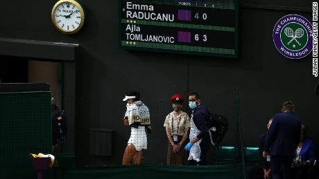 Raducanu goes off court for a medical time out against  Tomljanovic.