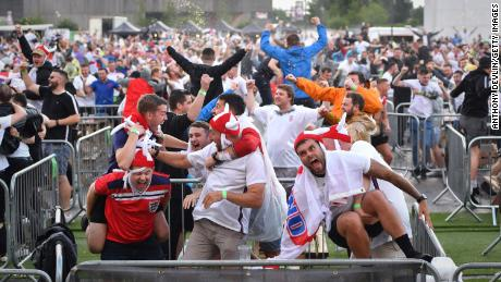England supporters celebrate Kane's first goal at the 4TheFans Fan Park at Event City in Manchester.
